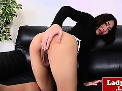 Shy ladyboy tugging herself sensually