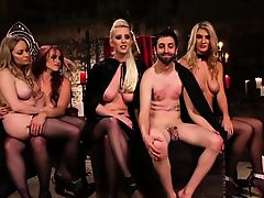 Ballbusting scene with masked dominas