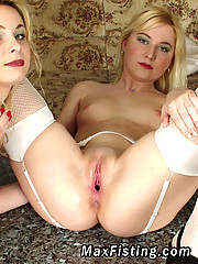 Pretty blonde fisting her friend in hardcore lesbian action
