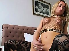 Sexy blonde shemale Camille Andrade shows off body and cums