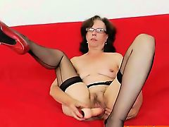 Slavena fucks her cunt and poses in panty-hose and heels