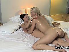 Oiled masseuse tribbing brunette babe