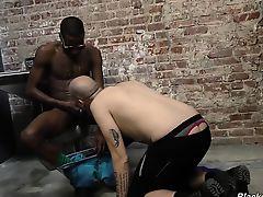 Tattooed white guy rides black cock in prison